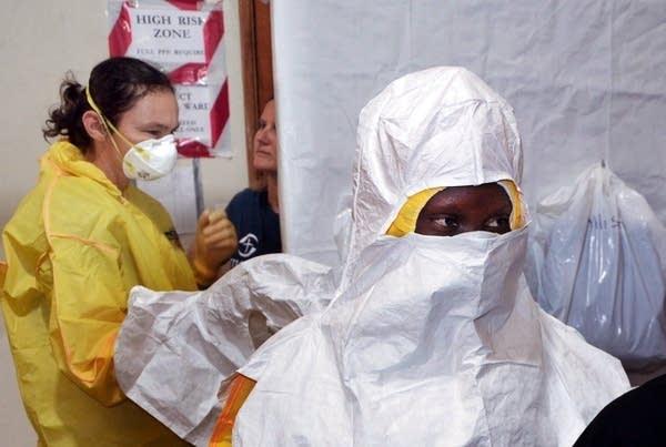 Samaritan's Purse staff putting on protective gear