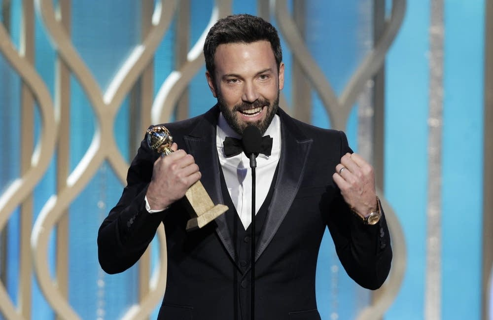 Ben Affleck with his award