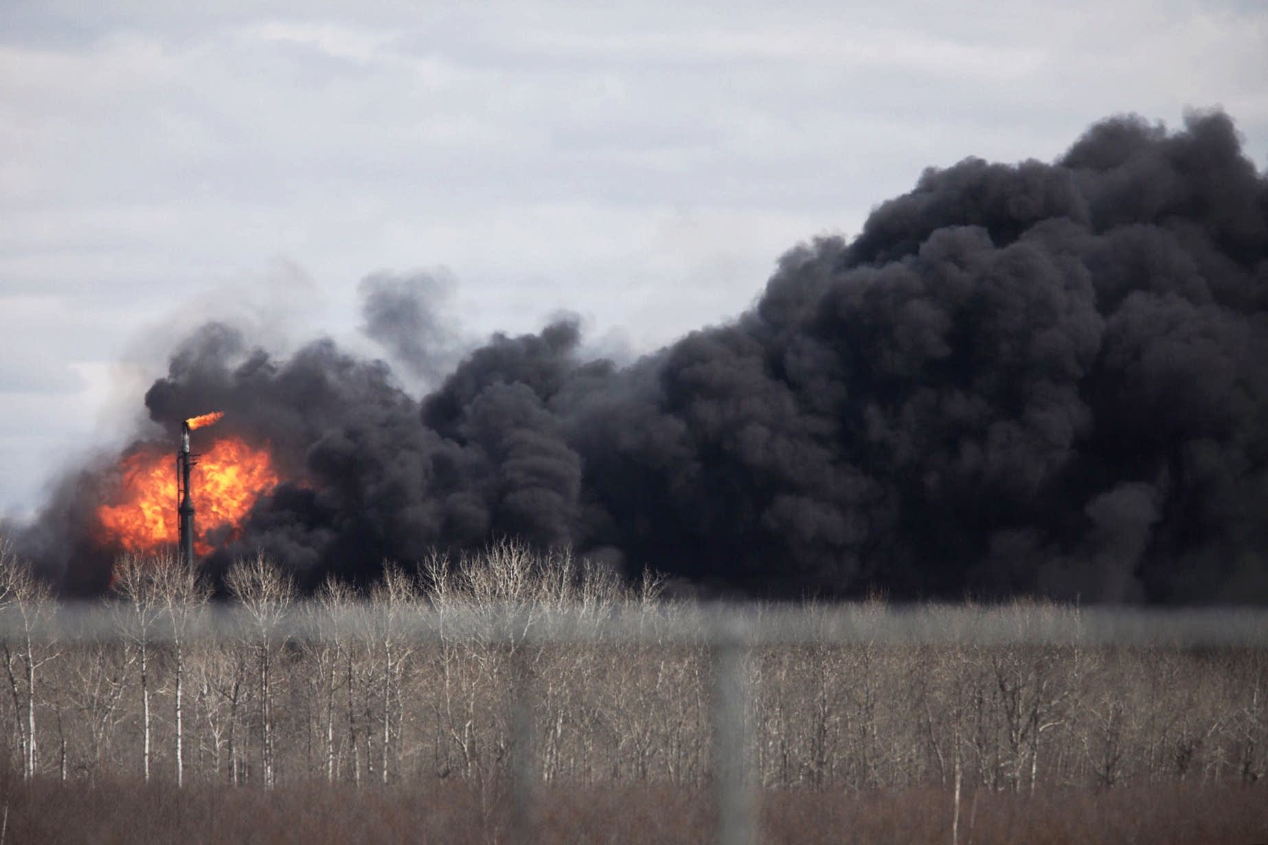 Explosions continue into the afternoon from the Husky Energy oil refinery.