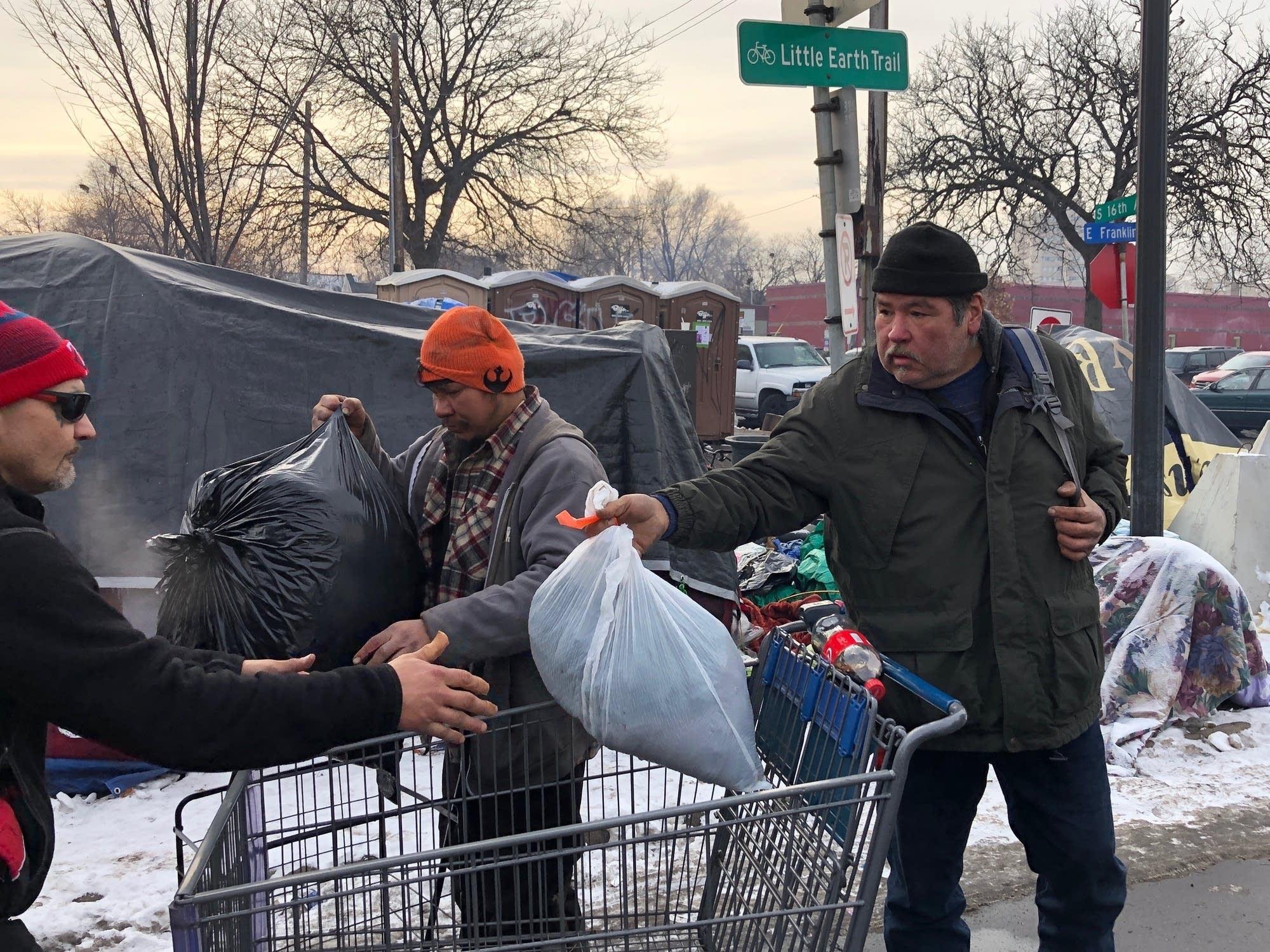 James Loerzel (right) packs up his belongings to move.