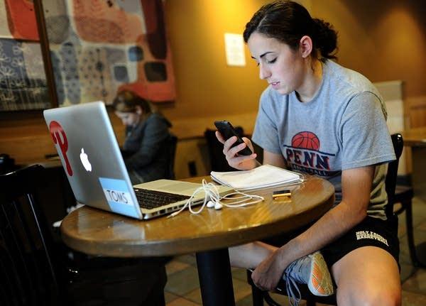 Woman on smartphone, laptop