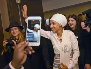Ilhan Omar waves to supporters.