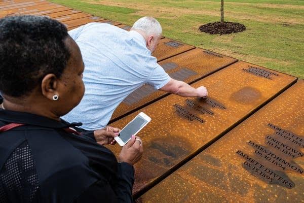 Warren Read touches a steel column.
