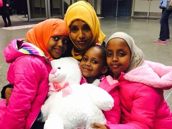 Mushkaad Abdi is reunited on Thursday with her mother and sisters.