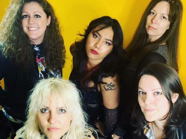 Five rockers looking into camera.