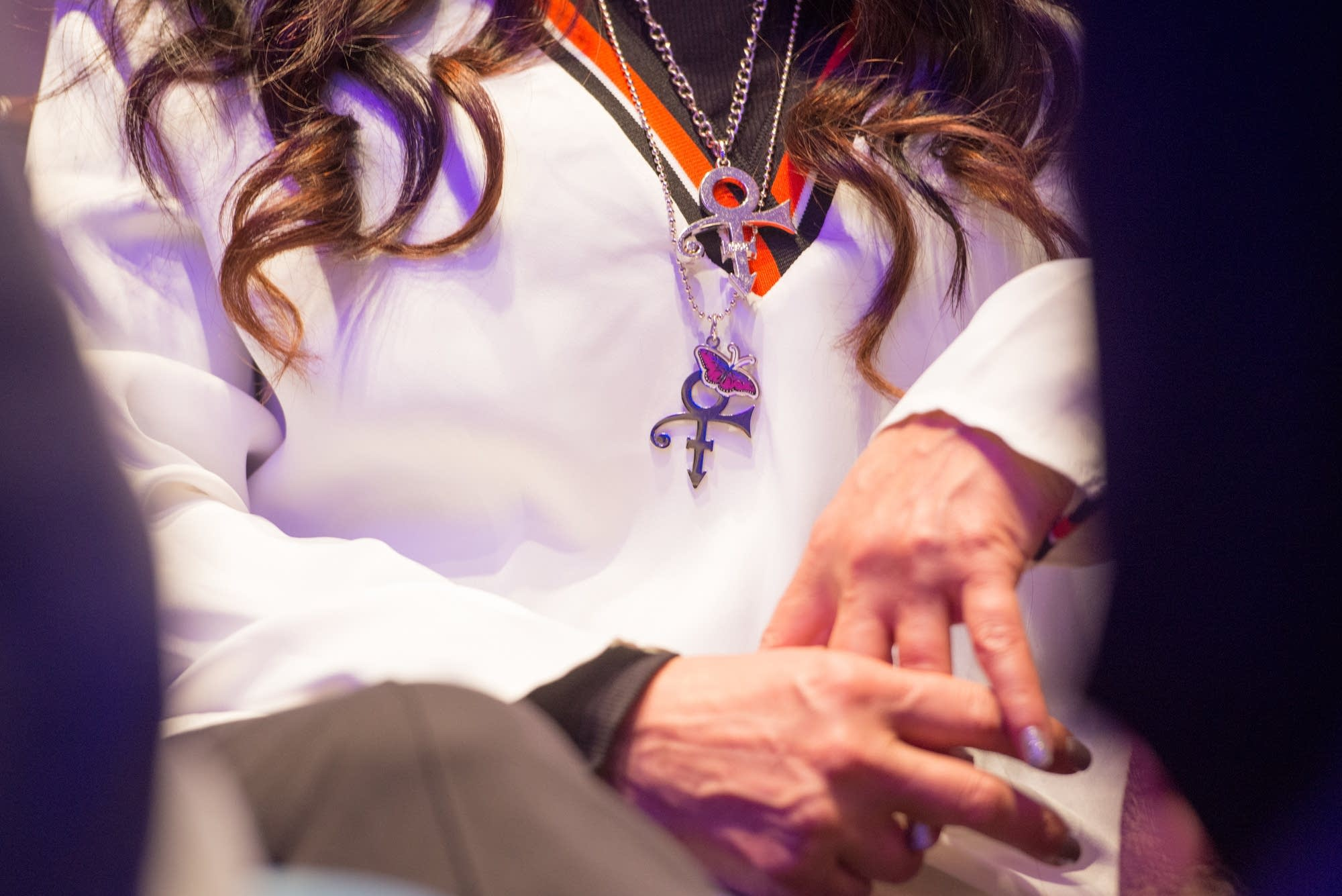 Sheila E wears layers of Prince necklaces.