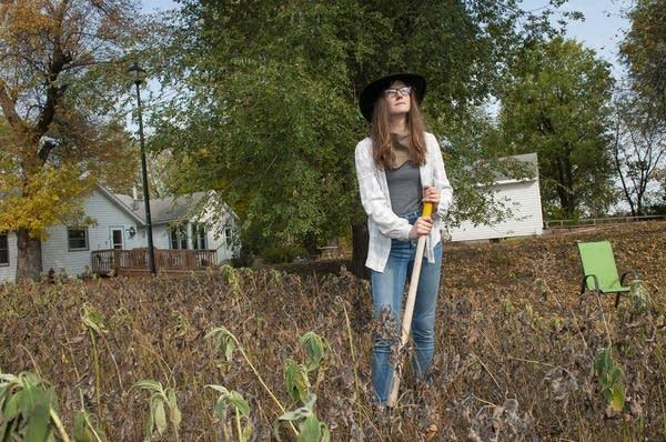 A woman standing in a garden