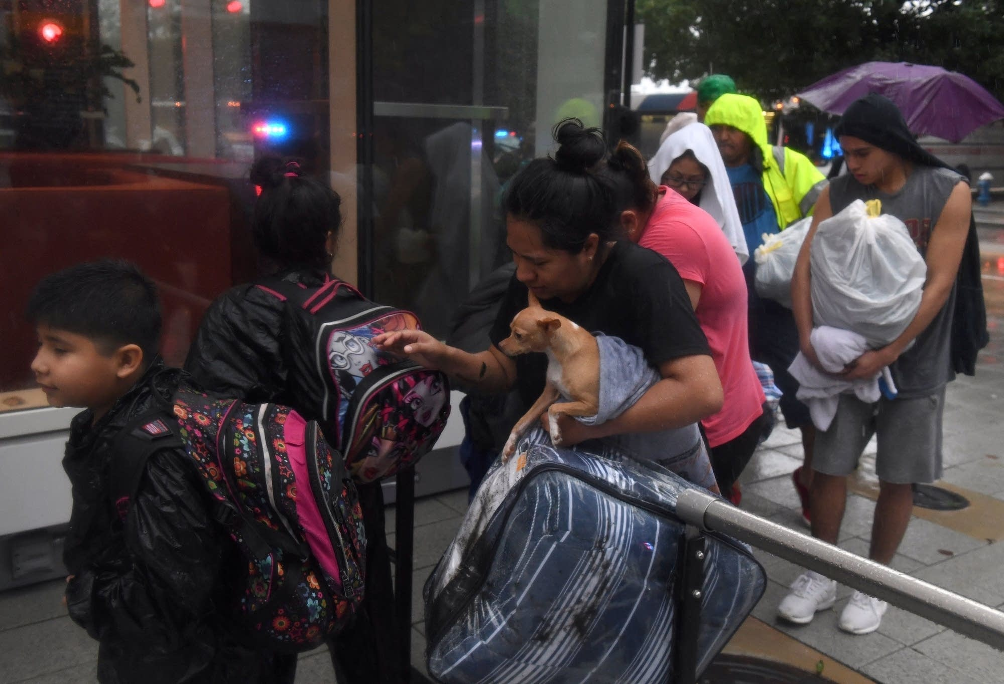 Evacuees arrive at the Convention Center shelter after evacuating.