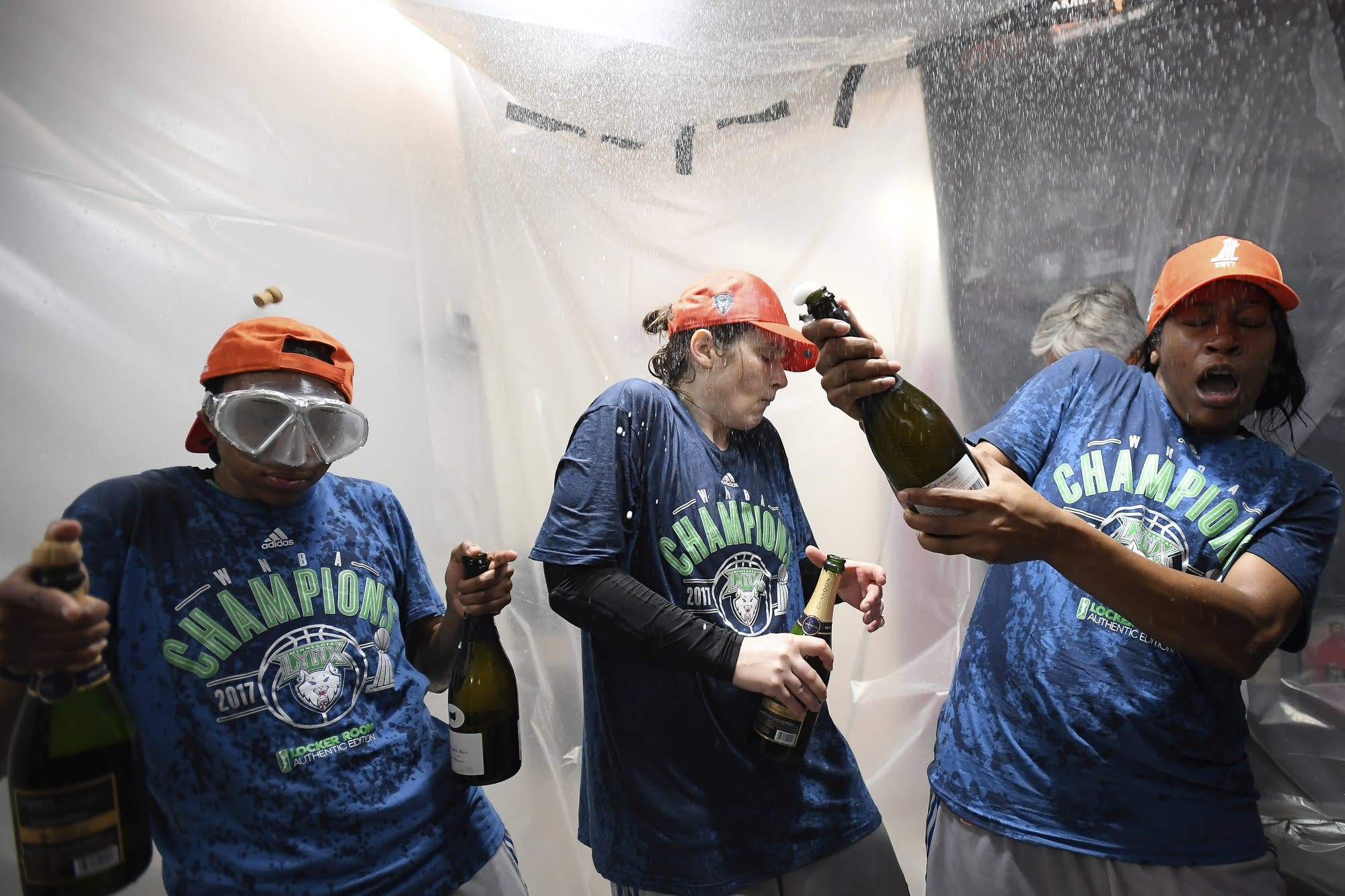 Lynx player celebrate with champagne after winning the championship.