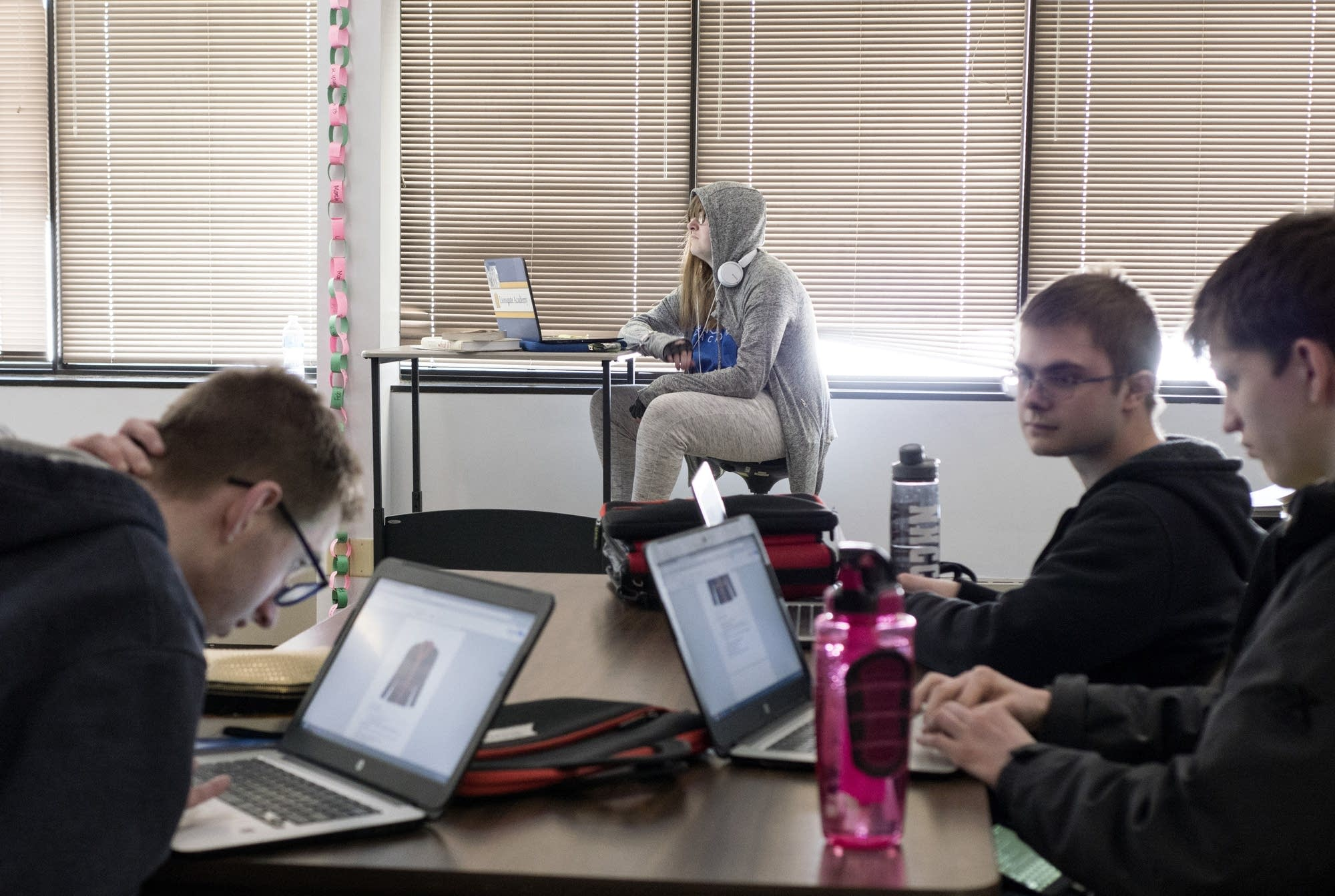Students work in a group while Raina Sellnow works on a solo assignment.