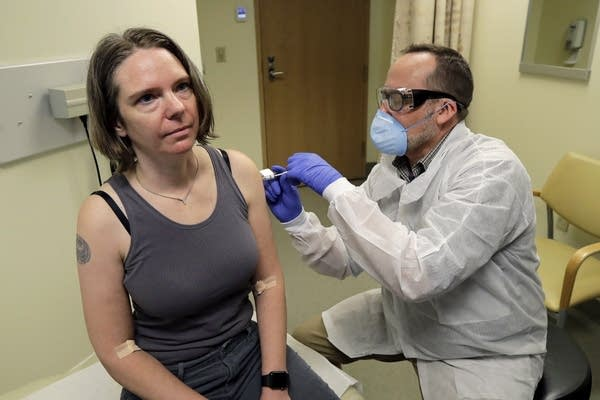 A woman gets a vaccine.