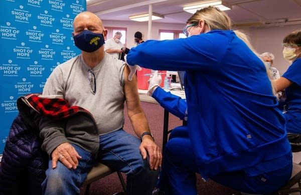 A percon receives a COVID-19 vaccine.