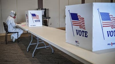 A national forewarning: Wisconsin's high absentee volume and ballot errors