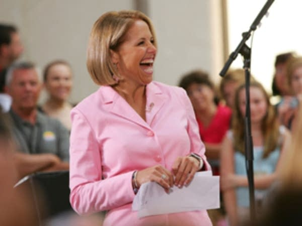 Katie Couric flashes a smile