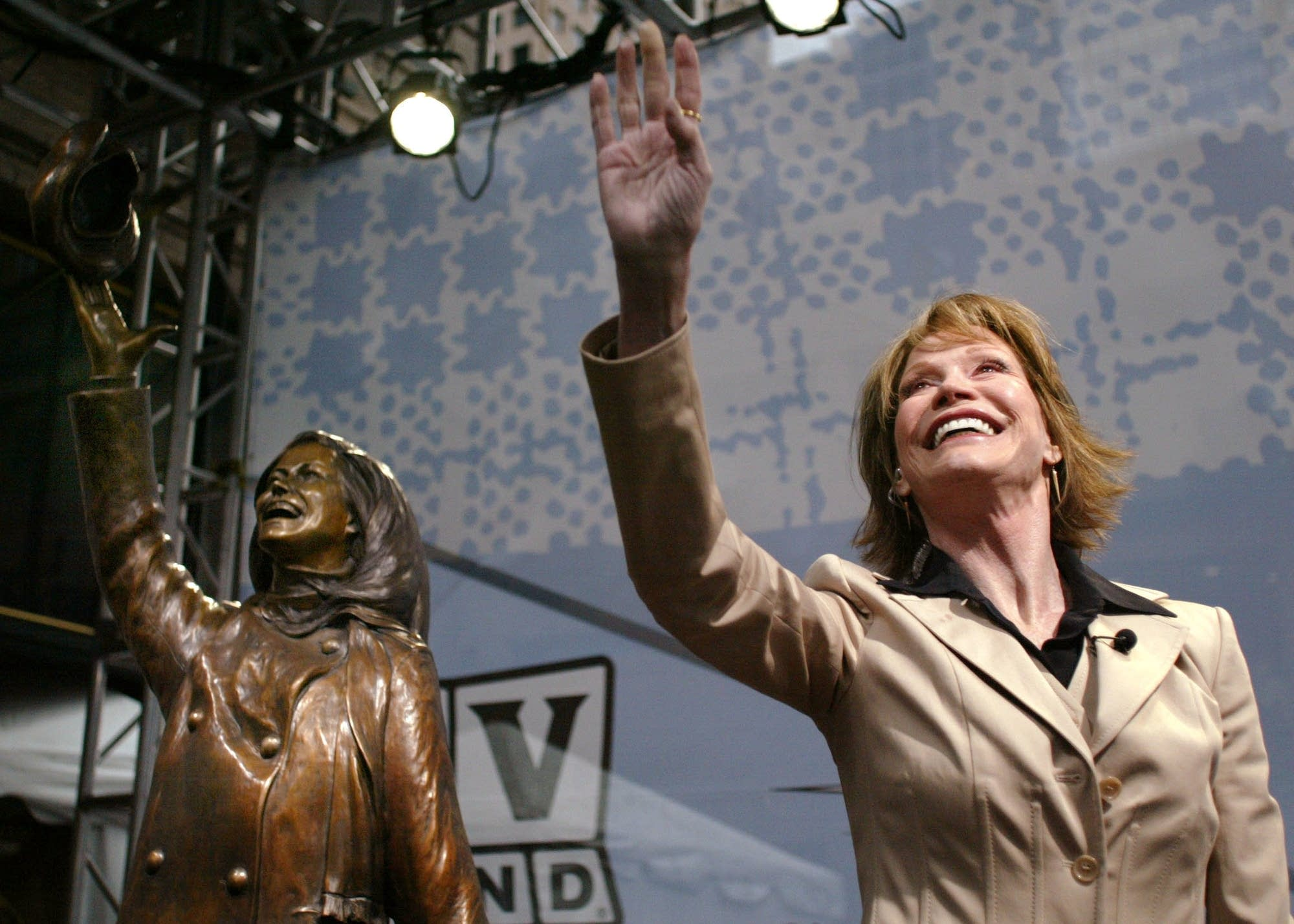 Mary Tyler Moore waves to the crowd in Minneapolis in 2002.
