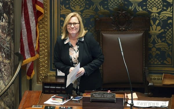 Senate President Michelle Fischbach smiles at photographers in the gallery.