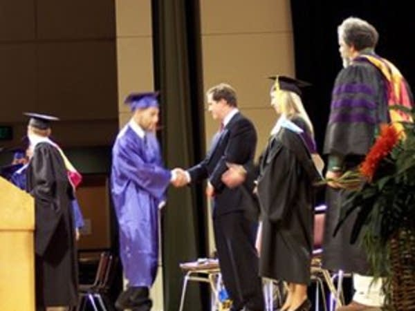 The graduation handshake