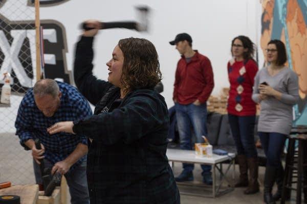 Angela Sylvester throws an axe at the bullseye at Bad Axe Throwing.