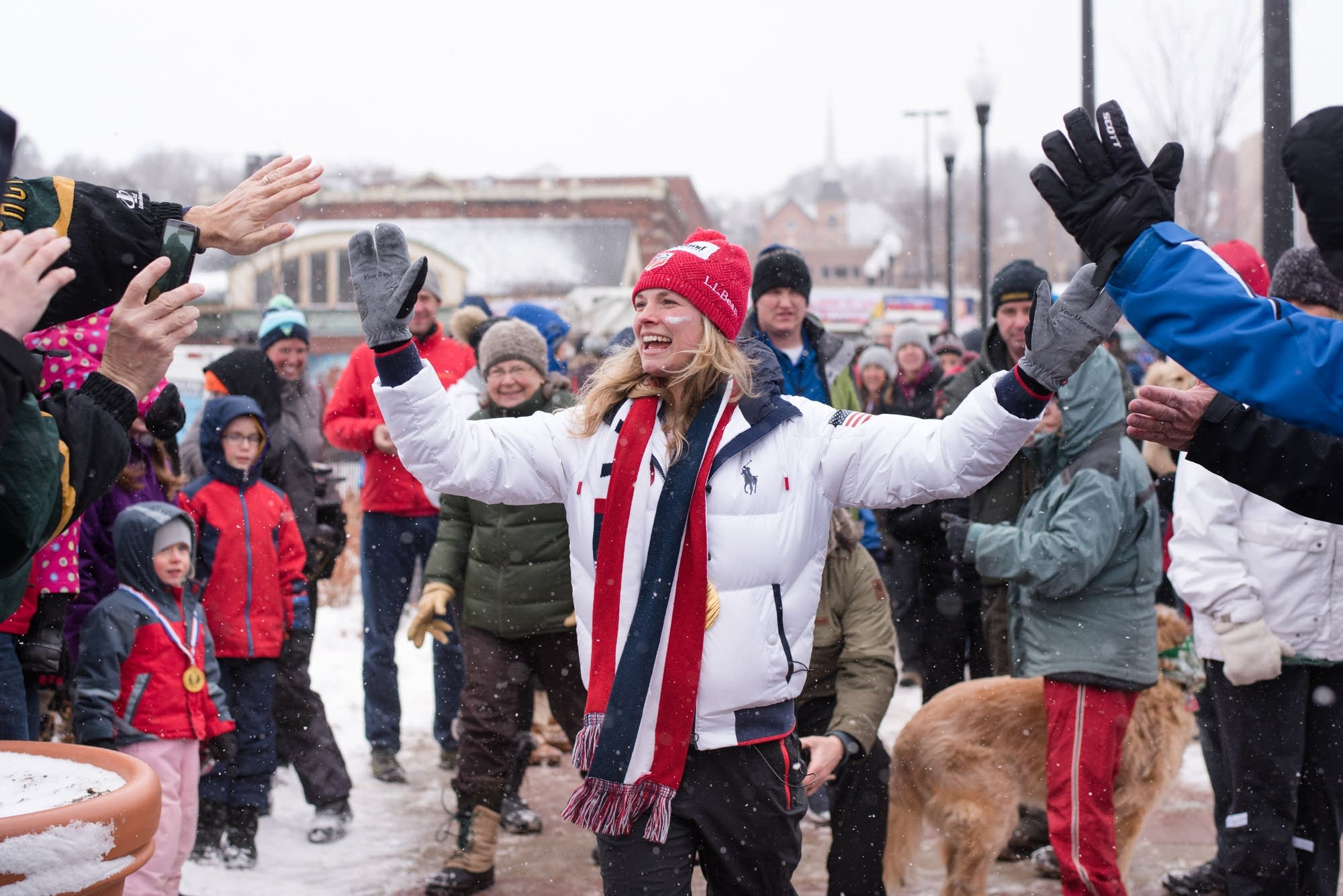 Olympic gold medalist Jessie Diggins greets a group of fans.