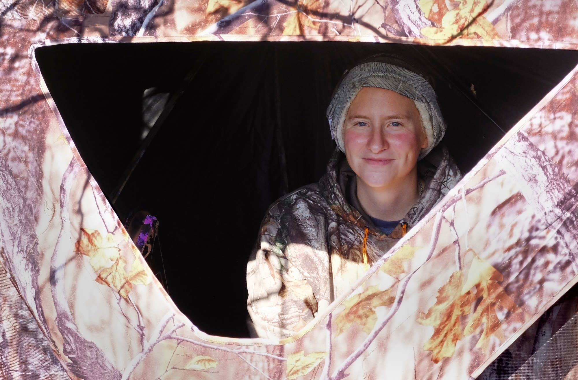Misty Stoll settles in to her deer hunting blind.
