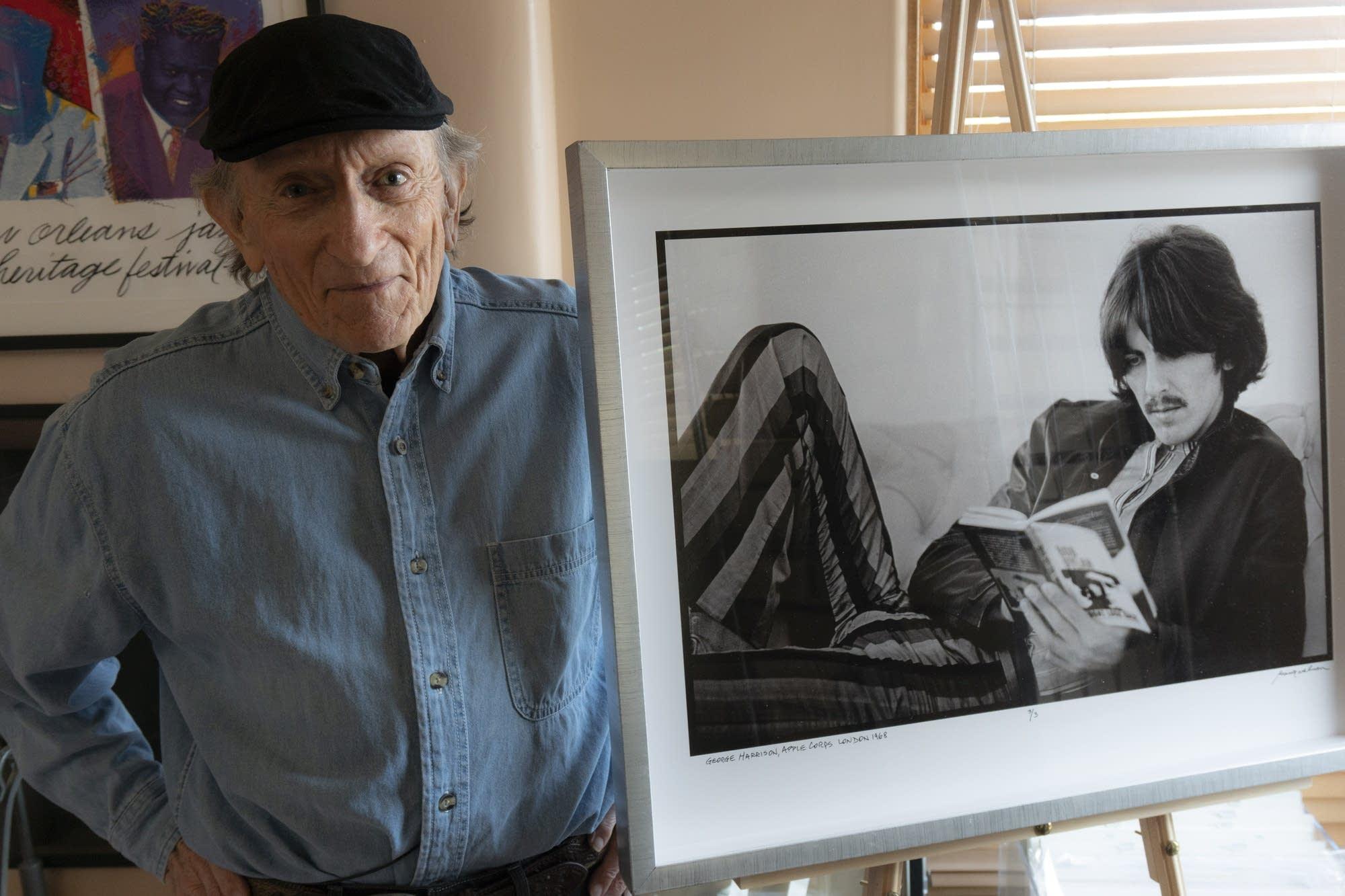 Photographer Baron Wolman with photo of George Harrison