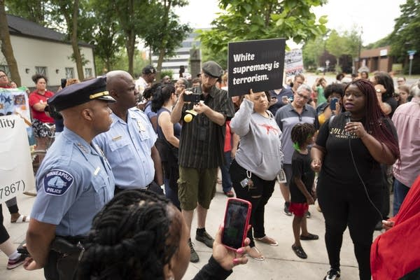 Nekima Levy-Pounds speaks to the Minneapolis police chief