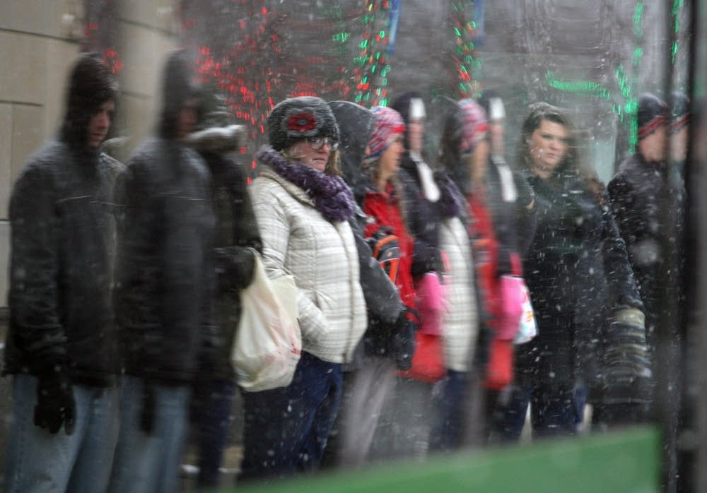 Commuters in a Rochester snow storm