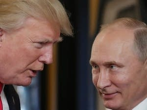 President Donald Trump chats with Russia's President Vladimir Putin