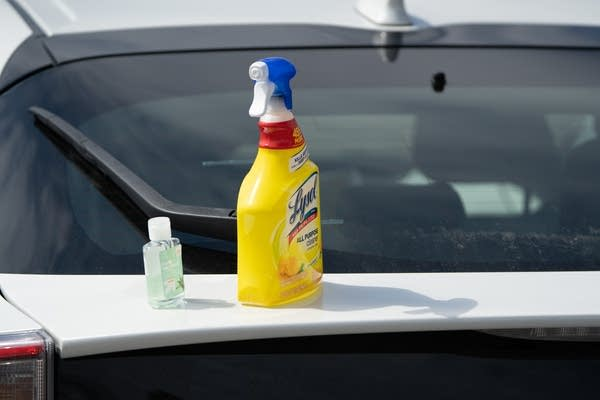 Lysol spray and hand sanitizer on a trunk.
