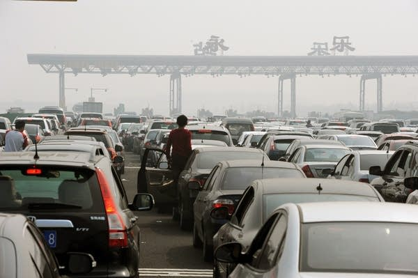 Chinese motorists get out of their cars