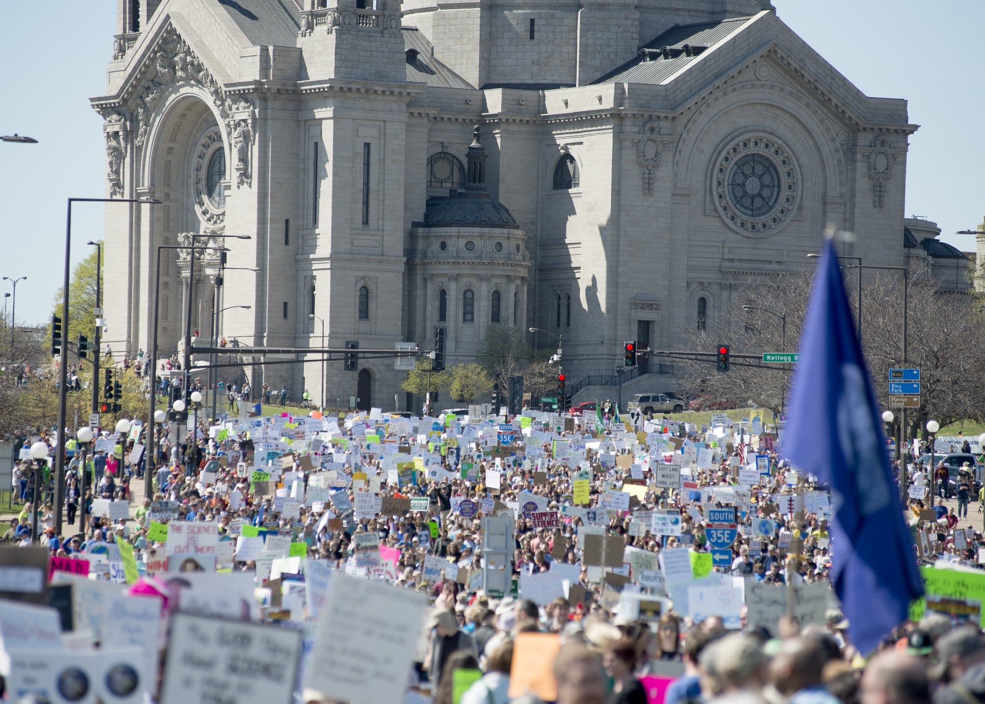 Marchers pass the Cathedral of St. Paul.
