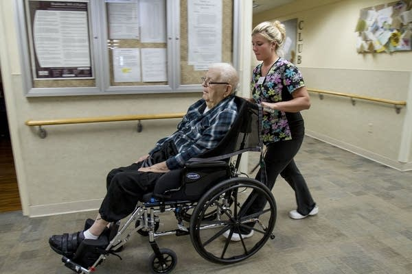 A nursing assistant wheeled a resident to lunch.
