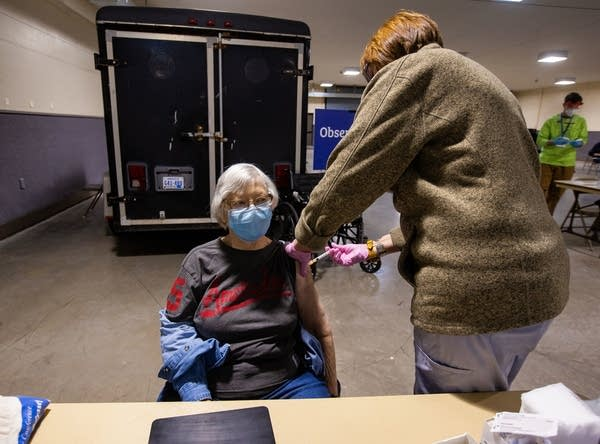 A woman receives a vaccine