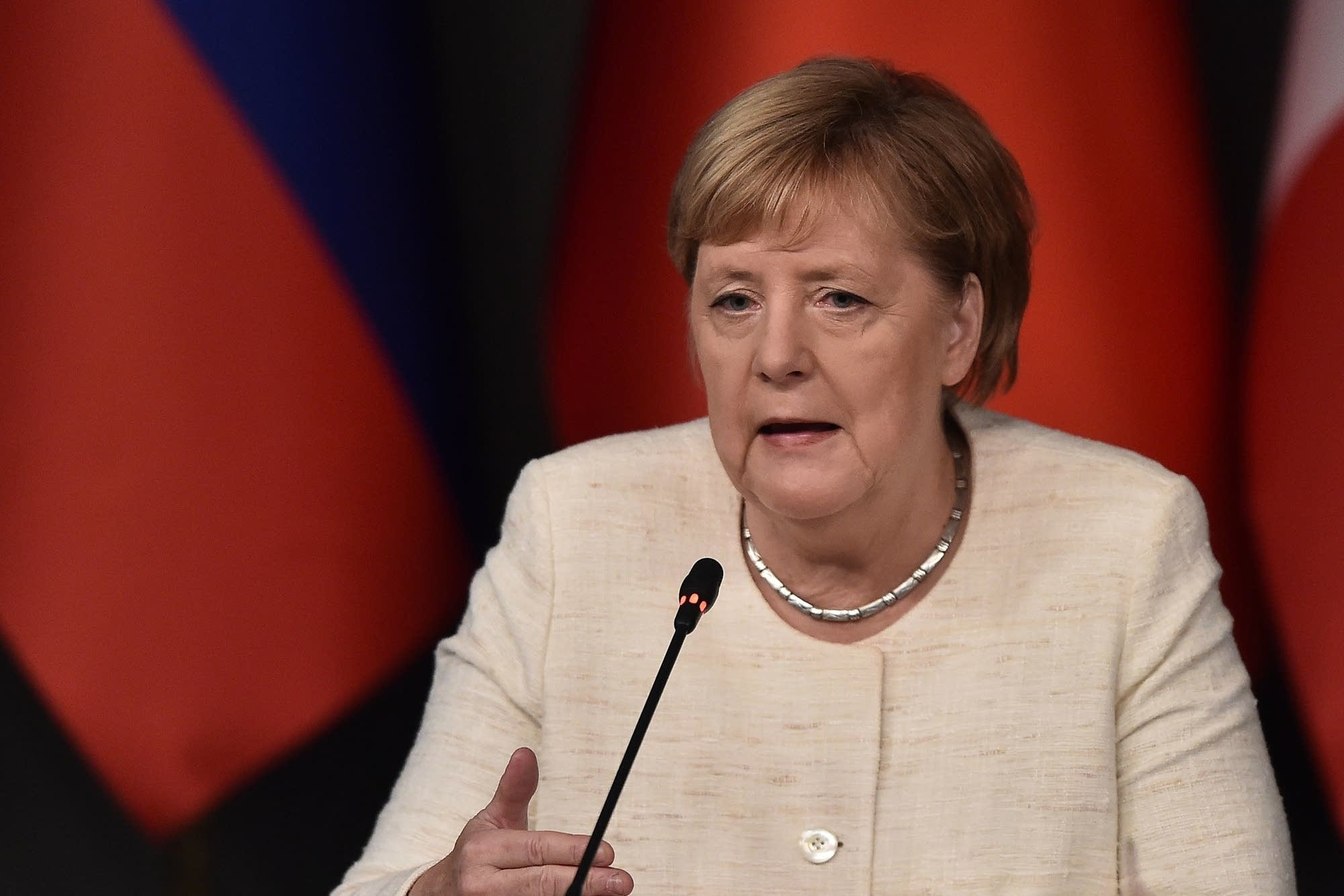 German Chancellor Angela Merkel attends a conference.