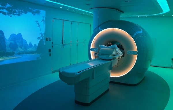 Brandt Williams gets an MRI on his knee in a new MRI scanner.
