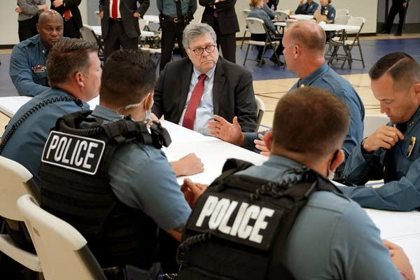 Attorney General William Barr participates in a roll call with police.