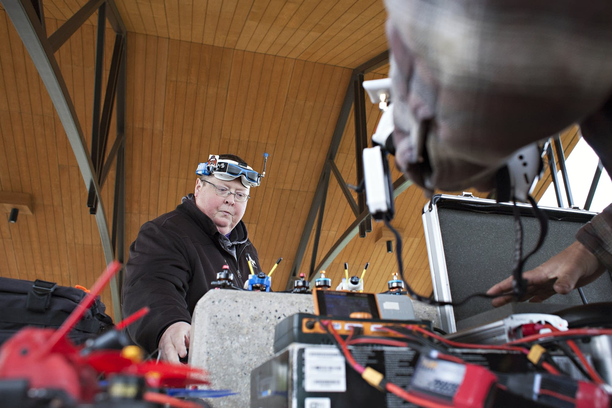 Pilot Tony Bjerke of Fargo prepares his drone and related gear for a race.