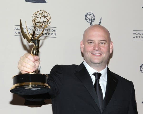 Trevor Morris poses with his Emmy Award