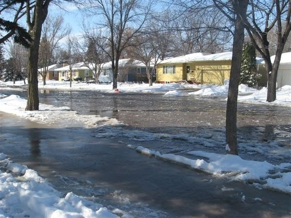 Rising water freezes on the streets of Moorhead