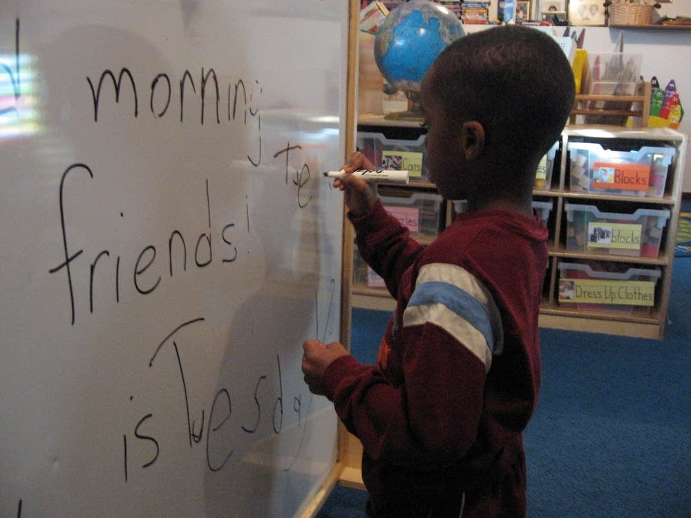 Ishmael Powell practices his spelling