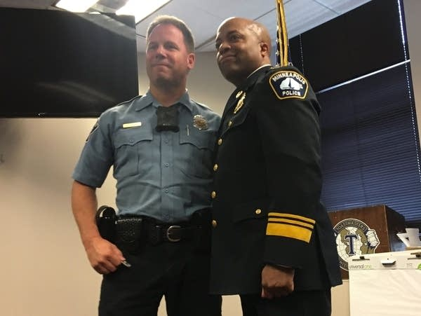 Officer Dean Milner is honored by Minneapolis Police Chief Arradondo.