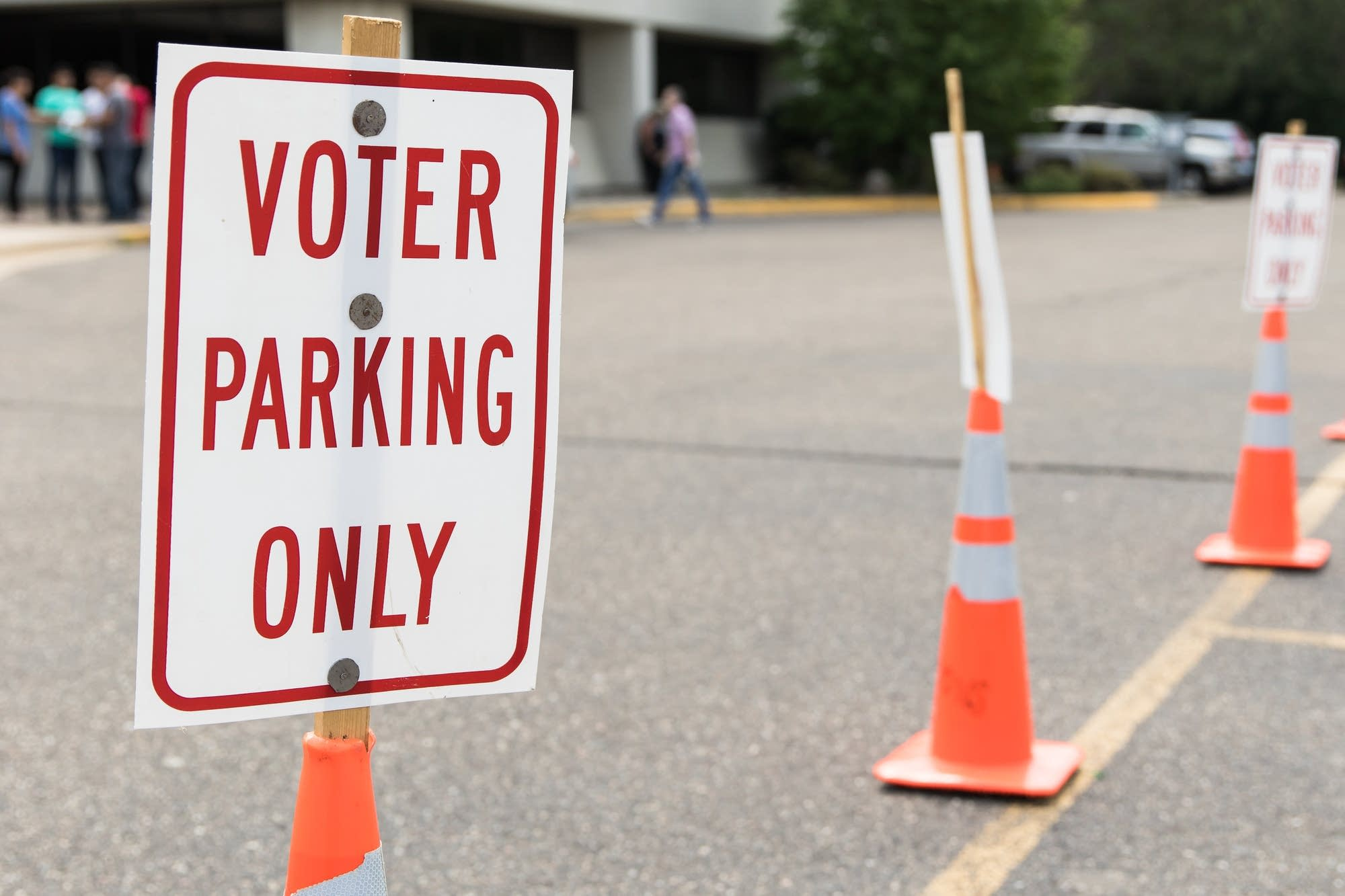 Signs mark parking spots that are reserved for voters.