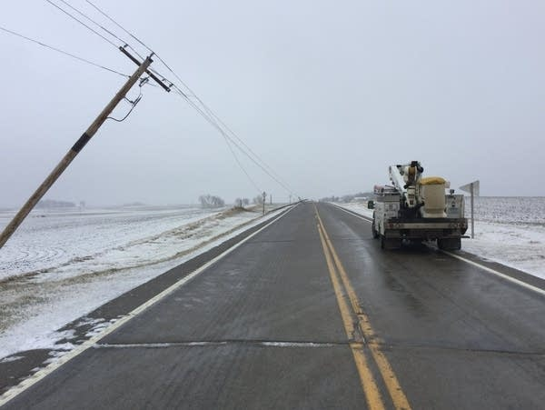 Damaged power poles are seen along a southern Minnesota highway
