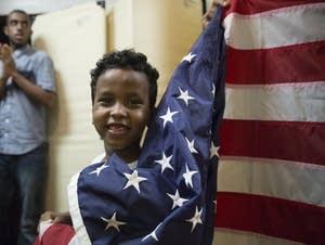 Boy waves flag