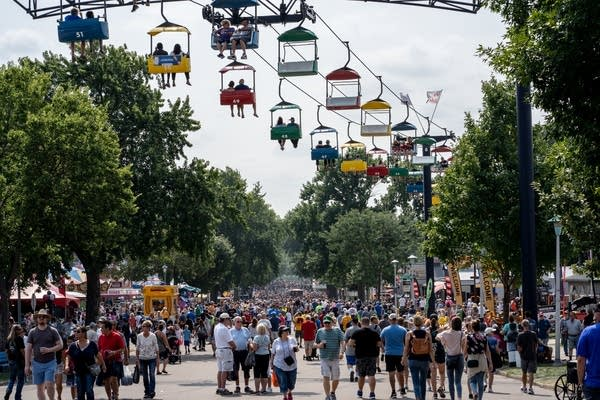 Crowds pack the streets and the sky ride on the first day of the Fair.