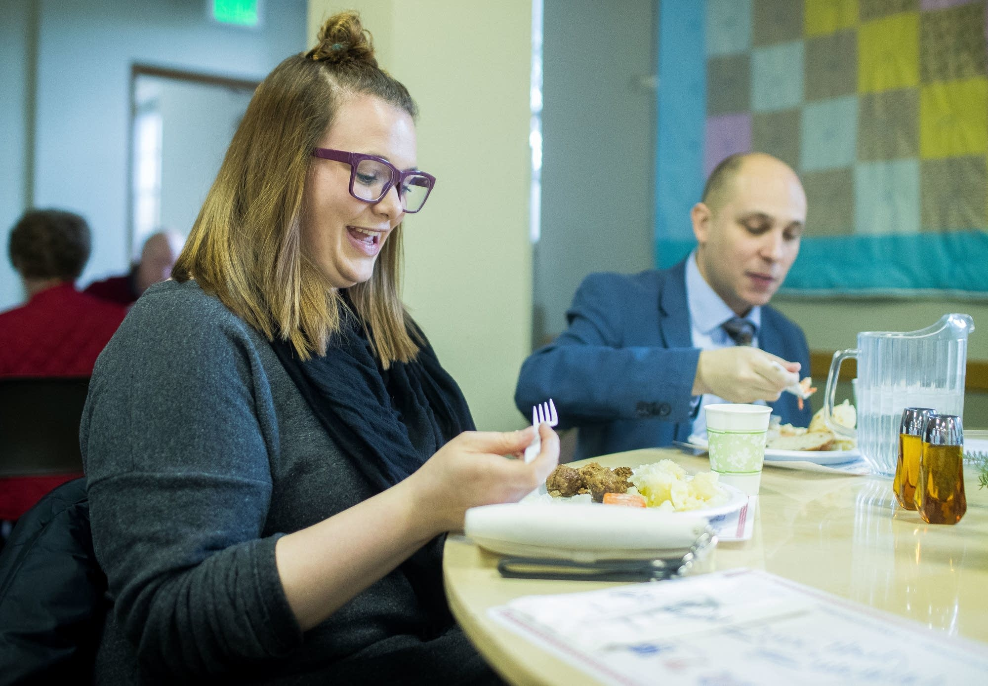 Leah Damon takes her first bite of lutefisk during the annual dinner.