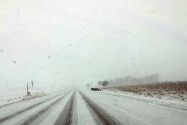 Snow blows across a road