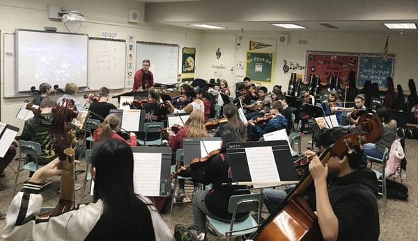 Students are squeezed into a regular classroom for band class.