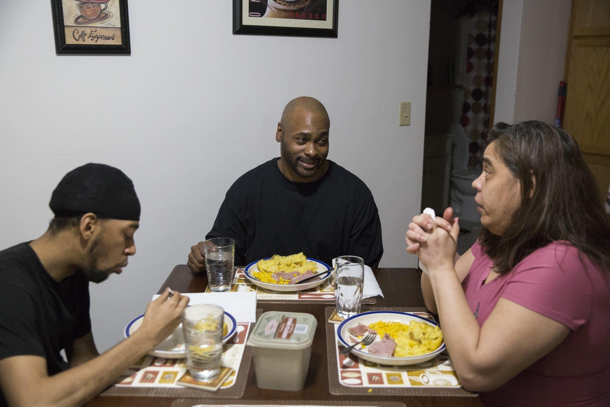 Adoniyah Israel eats dinner with his wife, Aviyah.