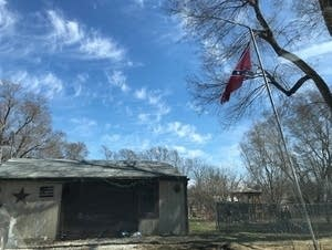 A Confederate flag flies outside a building in Clarence, Ill.